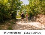 runners training outside while... | Shutterstock . vector #1169760403