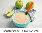 bowl of healthy baby food on... | Shutterstock . vector #1169764996