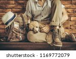 young man with dog and backpack ... | Shutterstock . vector #1169772079