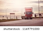 asphalt road with a truck.... | Shutterstock . vector #1169791000