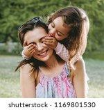 happy mother and daughter... | Shutterstock . vector #1169801530