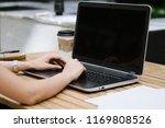 hands on laptop. | Shutterstock . vector #1169808526