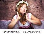 beautiful woman in a... | Shutterstock . vector #1169810446