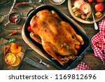 roast christmas duck with thyme ... | Shutterstock . vector #1169812696