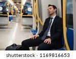exhausted commuter portrait... | Shutterstock . vector #1169816653
