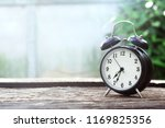 black alarm clock classic on... | Shutterstock . vector #1169825356