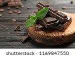 pieces of dark chocolate with... | Shutterstock . vector #1169847550