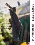 one sock hang of a clothes line | Shutterstock . vector #1169852599