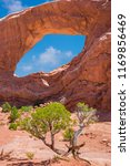 sandstone arch in arches... | Shutterstock . vector #1169856469