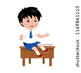 schoolboy sitting on the the... | Shutterstock .eps vector #1169861113