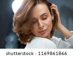 healthy hair. beautiful woman... | Shutterstock . vector #1169861866