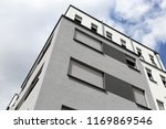 building with modern facade... | Shutterstock . vector #1169869546