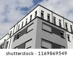building with modern facade... | Shutterstock . vector #1169869549