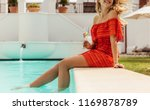 beautiful woman sitting on the... | Shutterstock . vector #1169878789