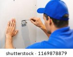 electrician installing... | Shutterstock . vector #1169878879