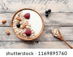 healthy breakfast on wooden... | Shutterstock . vector #1169895760