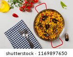 traditional paella with mussels.... | Shutterstock . vector #1169897650