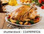 roast chicken whole. served on... | Shutterstock . vector #1169898526