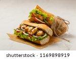 chicken sandwich with tomato ...   Shutterstock . vector #1169898919