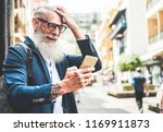 trendy senior man using... | Shutterstock . vector #1169911873
