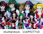 dolls in traditional costumes | Shutterstock . vector #1169927710