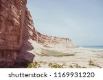 towering red sandstone cliffs... | Shutterstock . vector #1169931220