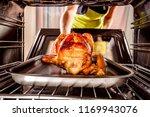 housewife prepares roast... | Shutterstock . vector #1169943076