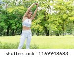 attractive young woman wearing... | Shutterstock . vector #1169948683