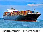 container ship approaching the... | Shutterstock . vector #1169955880