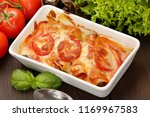 caneloni stuffed with meat and... | Shutterstock . vector #1169967583