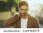 young man wearing winter... | Shutterstock . vector #1169983579