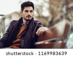 thoughtful young man sitting on ... | Shutterstock . vector #1169983639