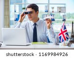 sales agent working in travel... | Shutterstock . vector #1169984926