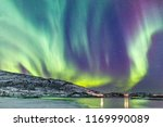 incredible northern lights... | Shutterstock . vector #1169990089