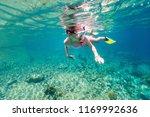 underwater photo of young girl...   Shutterstock . vector #1169992636