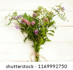 bouquet of wild flowers on a... | Shutterstock . vector #1169992750