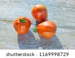fresh red big tomatoes on ... | Shutterstock . vector #1169998729