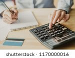 cropped view of accountant... | Shutterstock . vector #1170000016