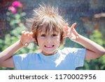 cute little boy with static... | Shutterstock . vector #1170002956