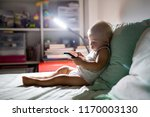 baby boy  playing in bed at... | Shutterstock . vector #1170003130