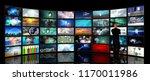 man in suit stands before media ... | Shutterstock . vector #1170011986