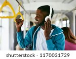 man in headphones listening... | Shutterstock . vector #1170031729