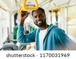 man in headphones listening... | Shutterstock . vector #1170031969
