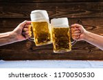hands holding mugs of bavarian... | Shutterstock . vector #1170050530