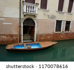 old building and boat on a...   Shutterstock . vector #1170078616