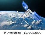 satellite above the earth makes ... | Shutterstock . vector #1170082000
