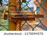 rusty gate lock close up | Shutterstock . vector #1170094570