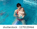 baby with mom learns to swim in ... | Shutterstock . vector #1170120466