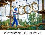 happy boy on the zip line.... | Shutterstock . vector #1170149173