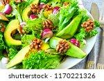 green salad with avocado  blue... | Shutterstock . vector #1170221326
